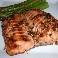 Salmon fillets are marinated in an Asian inspired sweet and spicy marinade before grilling.