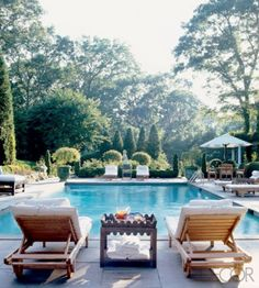 Layered landscape - pool and grounds at the Hamptons home of Charlotte Moss - Elle Decor
