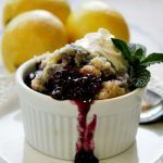 Crock-Pot Blueberry Lemon Cobbler – Juicy blueberries are combined with the bright zest of lemon in this amazing recipe for Slow Cooker Blueberry Lemon Cobbler! The perfect summer dessert! If desired top the warm cobbler with a scoop of vanilla ice cream or some luscious whipped cream! SO GOOD! | CrockPotLadies.com