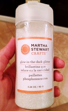 Glow in the dark glitter. Glue onto pumpkin - shows up white during the day, glows at night