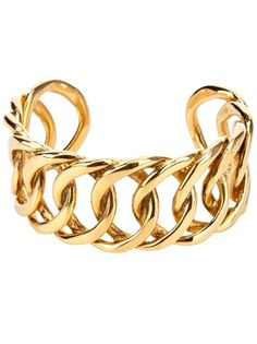 Gold-tone cuff from Chanel Vintage featuring large circular links. Please note that vintage items are not new but often between 20 and 50 years old, and therefore will always have minor imperfections, even when the items have been used with love and care.