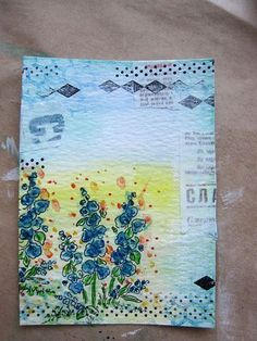 Daniela Dobson  Gesso over washi tape.  Really nice blending effect.
