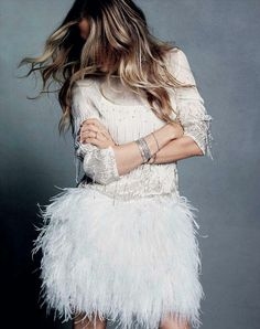 feather skirt, sequin shirt, rhinestones 'round the wrist . . . the butterflies are flutterin':