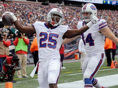 Buffalo Bills running back LeSean McCoy (25) celebrates his touchdown with tight end Nick O'Leary, right, during the first half of an NFL football game against the New England Patriots on Sunday, Oct. 2, 2016, in Foxborough, Mass.