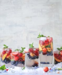 Rainbow Coconut Water Spritzers - Coconut Water Mocktail-Coconut water mocktails, made cuter by adding your favorite summer fruit! In rainbow colors of course. This is incredibly refreshing and perfect for summer! Coconut Water Recipes, Coconut Water Benefits, Low Calorie Cocktails, Healthy Cocktails, Healthy Smoothies, Juice Drinks, Mocktail Drinks, Fruit Drinks, Party Drinks