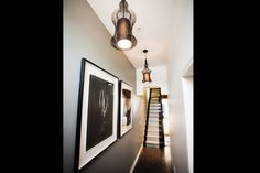 Dani and Dan's Hallway. The grey wall, artwork and two pendant lights work great. Shame about the racing stripe staircase #theblock2012