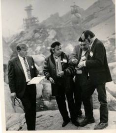 Rudy Ortega, also known as Chief Little Bear, talking with Boeing administrators at Rocketdyne in the Santa Susana Mountains, 1970s. Rudy Ortega Sr. was a leader and community organizer for the Fernandeño Tataviam Band of Mission Indians.The chief was registering the site with the State Historical society. San Fernando Valley History Digital Library.