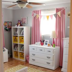 Tour a super cute pink, yellow and grey toddler girl bedroom complete with lots of DIY touches!