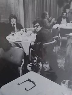 "Barry Feinstein, 1966: ""Savoy Hotel [?], London, 1966  From Feinstein:  ""This is the Savoy Hotel in London. Bob picked up Pennebaker's movie camera. He loved shooting with it, but I don't know if any of his footage made the cut."""