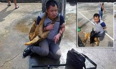 Two men who were caught killing and stealing dogs in a Chinese village were subjected to a brutal nine hour beating before having the dead animals' bodies tied around their necks.