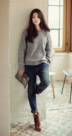 Knit pullover, cuffed jeans, laced ankle boots