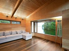 Architecture, Extraordinary Boathouse With Wooden Living Room With White Comfy Sofa Combined With Transparent Glass Window: Boat House Applying Dominative Wooden Constructions Painel Sandwich, Fraser Residence, Haus Am See, Floating House, Wood Panel Walls, Minimalist Living, Beautiful Buildings, House In The Woods, Custom Homes