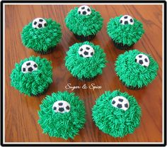 Soccer Cupcakes - cupcakes frosted in buttercream using the grass tip (#233) and store bought Wilton soccer ball.
