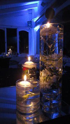 centro de mesa con velas flotantes
