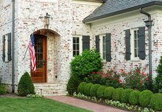 Love the limed brick look and the grey accents - Castle Homes