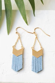 Fringe earrings by Shlomit Ofir with chevron, gold plated elements and thin faux-suede strands.