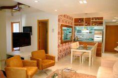 Sala de estar e jantar de um apartamento de 80 m², em Porto Alegre. Projetado por Caio Rodrigues de Santi.