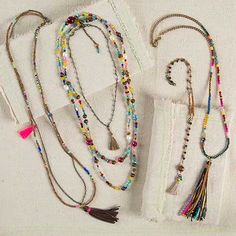 Gypsy Tassel Necklaces - The Gypsy Necklaces feaure an eclectic collection of different materials including colorful wood and glass beads, faceted crystals, genuine pearls, and bright boho tassels that accessorize any outfit with a little color and fun!