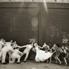The bridal party pulling apart the bride and groom. A must have.