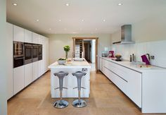 Island end stools provide an ideal social space to converse with the cook or have a bite to eat. Corian worktops provide hard wearing and easy to maintain surfaces. Bulthaup B1, Corian Worktops, Traditional Kitchen, Country Kitchen, Contemporary, Modern, Layout, Dining, Interior Design