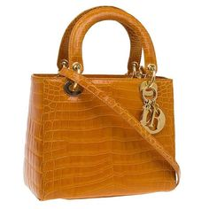 Rare Christian Dior Lady Bag Caramel Alligator Skin   From a collection of rare…