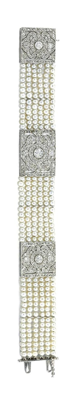 PEARL AND DIAMOND BRACELET,  CIRCA 1915.  Decorated with three open work plaques set throughout with circular-, single- and rose-cut diamonds, to the six rows of pearls, mounted in platinum, French assay and partially legible maker's marks, numbered, length approximately 182mm.