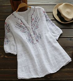 In a cosy style, this easy-to-wear casual embroidered top is an essential to add to your wardrobe for fall. More comfy o Kurta Designs, Blouse Designs, Blouse Patterns, Boho Fashion, Fashion Dresses, Embroidered Clothes, Embroidered Tops, Embroidery Dress, Blouse Styles