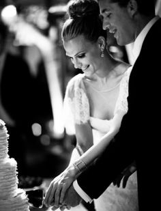 Molly Sims Wedding Couple cutting cake Black & White Gia Canali Photography.  cpbride.com/blog