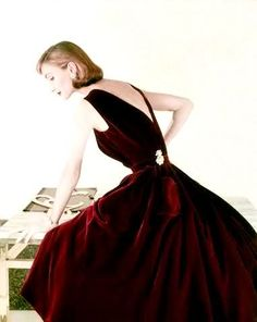 Evelyn Tripp in a v-backed, garnet velvet dress by Digby Morton, 1955