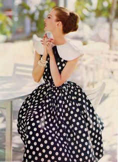 Model wearing a black and white polkadotted dress for Ladies Home Journal, 1958.
