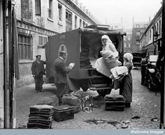 Ambulance Column depot, 9 Gower Street, London: loading up the blanket bus in the Mews. Sep 1918