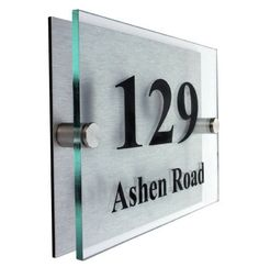 """Acrylic Master Modern House Sign by Acrylic Master. $24.99. Full fixing instructions included. UP TO 3 LINES OF TEXT. 5mm Glass look acrylic floated over 3mm brushed aluminium panel. 8"""" x 6"""" SIGN. PLEASE ADD GIFT OPTION AND LEAVE DETAILS HERE. Modern acrylic house number sign. Can be personalized with up to 3 lines of text. Plexiglass material guaranteed not to yellow for 10 years. Acrylic floated above brushed aluminium panel with 2 x chrome stand off fixings..."""