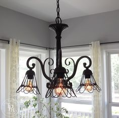 This is an easy DIY tutorial on how to makeover a chandelier in farmhouse style! Turn a boring old chandelier into beautiful farmhouse style lighting!