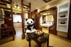 An employee dressed in a panda costume poses for a photo during the soft opening of a panda-themed hotel at the foot of Emei Mountain, in southwest China's Sichuan province, February 25, 2013. According to local media, the hotel is the first panda-themed hotel in the world and will officially open in May with room rates from 300 ($48) to 500 yuan per night. REUTERS-China Daily