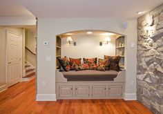 Basement with Rustic Stone Walls and Sleeping/Reading Alcove
