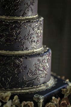 Ornate black-and-gold wedding cake