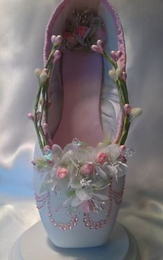 Sweet pink and white decorated pointe shoe. by DesignsEnPointe | I love decorated point shoes but they are probably really hard to dance in!
