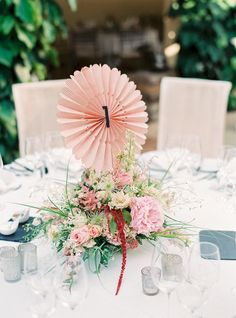 Cute pink centerpieces with pinwheel table numbers | Photography by Birgit Hart Fotografie, Florals by Lebahn Floristik