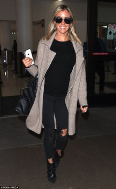f5980d7711f5 Kristin Cavallari rocks casual chic ensemble in black ripped denim