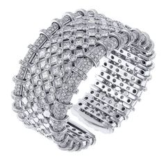 An absolutely stunning diamond cuff bracelet. Made in Valenza by master jewelers RCM Gioielli this outstanding boasts over 18 carats of stunning white diamonds. Measuring an inch and quarter wide this bracelet has a presence all its own. Set in 18 karat white gold.Circa 1990s