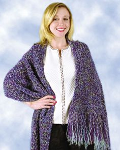 This shawl is the perfect crochet pattern for those who are just learning to crochet. A lavender color is used, while you have the option of adding fringe or keeping it clean-cut.