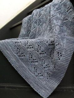 """A snuggly blanket to knit for baby in three sizes (carriage/sm crib square/lg crib square) with lots of cushy texture to burrow into, yet light enough to be a go-to traveling accessory. Deep garter borders ensures the piece will lay flat and keep its shape through multiple washings, making this a practical, pretty gift to knit for an expecting family. Substituting yarn and/or needles will result in an overall variation in size.Gauge: 22 sts and 30 rows = 4"""" in stockinette or larger needles…"""