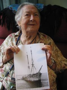 LONG MEMORY: Cecelia Ryan, 100, pictured with the last relic of our windjammer era, the barque Adolphe, wrecked on Stockton breakwater in 1904. Photo: Mike Scanlon