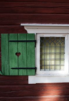 Red house with green details Satar, Dalarna, Sweden I love the heart! Swedish Cottage, Swedish House, Red Houses, Swedish Style, Window Sill, Window Casing, Window Dressings, Scandinavian Home, Windows And Doors