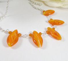 Orange necklace, by romanticcrafts on Etsy, $18.00