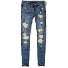 Hollister Shredded Low-Rise Super Skinny Jeans found on Polyvore featuring jeans, pants, bottoms, calças, denim, destroyed medium wash, torn skinny jeans, blue jeans, faded skinny jeans and destroyed skinny jeans