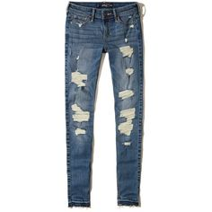 Hollister Shredded Low-Rise Super Skinny Jeans found on Polyvore featuring jeans, pants, bottoms, calças, denim, destroyed medium wash, torn skinny jeans, blue jeans, faded skinny jeans and destroyed skinny jeans