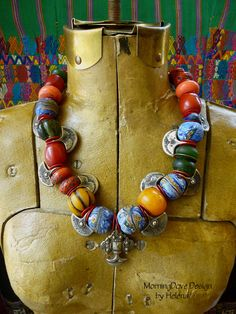 Necklace   Helena Nelson-Reed. Deep red vintage Ethiopian ' cherry amber' resin beads, large vintage and contemporary Tibetan salmon colored glass 'sherpa beads', Naga pewter pendants and mixed old and modern glass beads