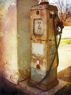 rusted vintage gas pump. Would be fun to build a replica of this with the kids. The mooncars on the playground could use a gas pump.