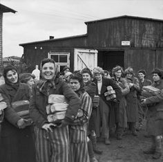 THE LIBERATION OF BERGEN-BELSEN CONCENTRATION CAMP, APRIL 1945. Cheerful women inmates collect their bread ration from one of the five camp cookhouses.